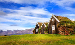 Grass houses and blue skies