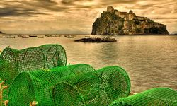 Fishing nets with cliff in background