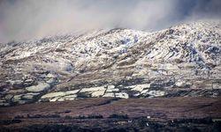 A snowy scene of mountainous Cork