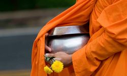 A Monk Holding a Rice Bowl