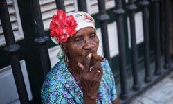 A Cuban woman smoking a cigar