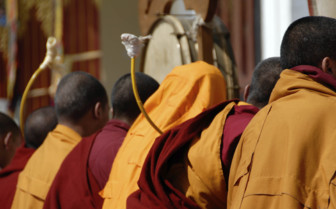 Seated Monks in Red and Yellow