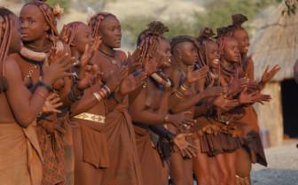 Namibian women sing and dance