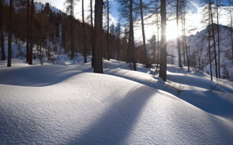 Winter sun in snowy mountains