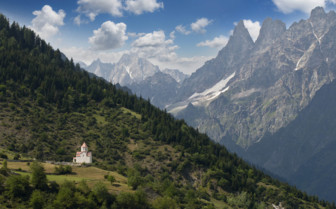 Caucasus mountains with view to small church