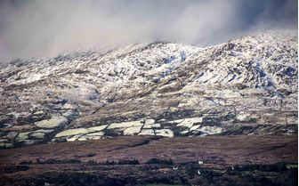 A snowy scene of mountainous Cork