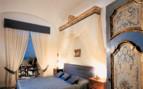 The luxury bedroom at Santa Caterina hotel