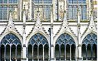 This image depicts the cloister windows of Canterbury Cathedral