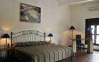 Bedroom at Casa Oaxaca hotel