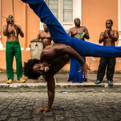 People Practicing Capoeira