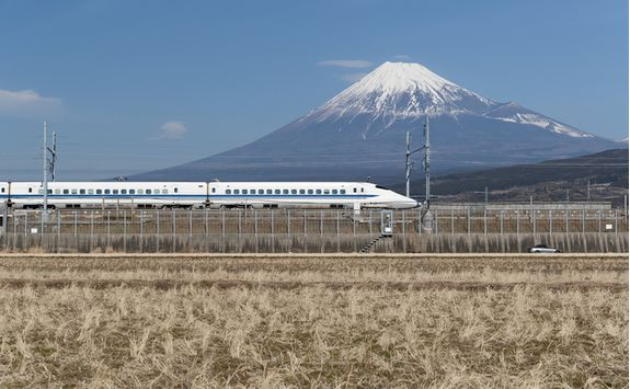 Bullet train travelling past Mount Fuji