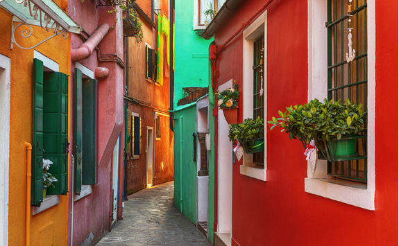 alley of coloful buildings of burano