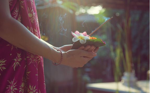 woman holding typical balinese temple offering