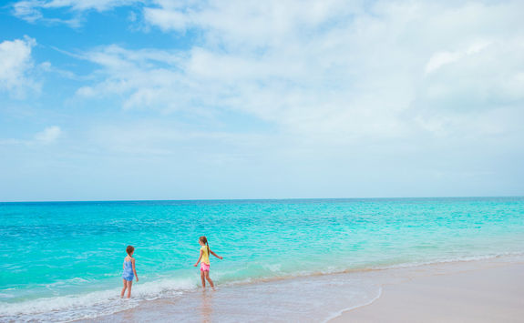 Girls playing on a beach in Antigua