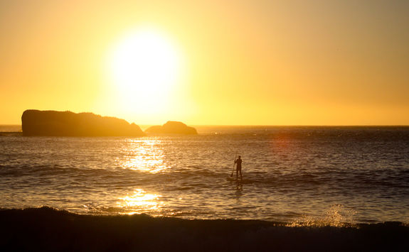 Paddle boarding on sunset