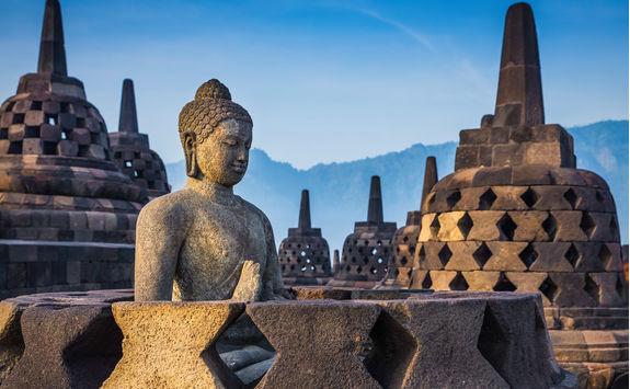 Ancient buddha statue and stupa at Borobudur Temple