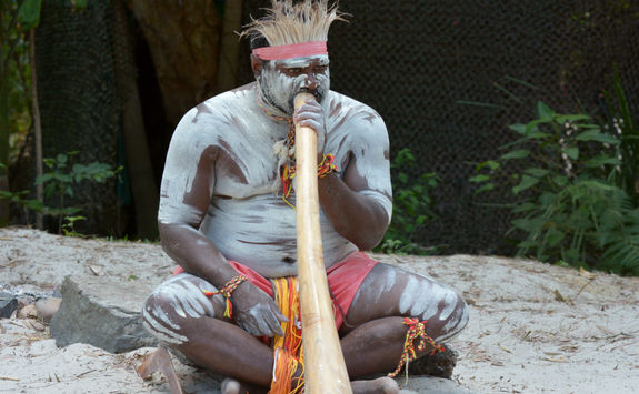 Aboriginal playing didgeridoo