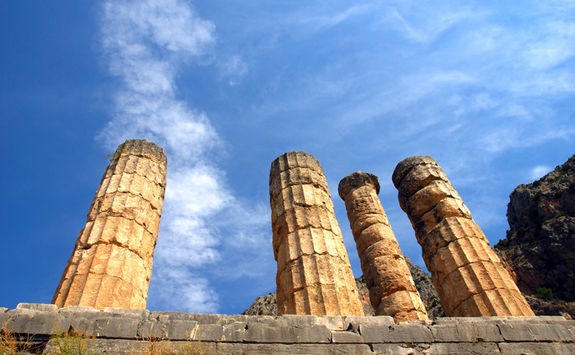 Low view of the remaining columns of a temple in Mycenae