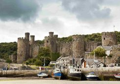 Conwy Castle with harbour in the foreground