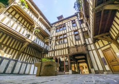 Medieval courtyard surrounded by half medieval houses
