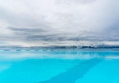 Open-air infinity pool overlooking the ocean in Hofsos