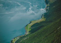 Curvy road by fjord in Norway