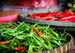Close-up chilies in a basket in a market