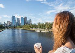 Woman on bridge overlooks Melbourne