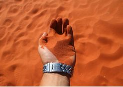 Red sand in hand
