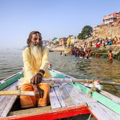 man-on-ganges-in-boat