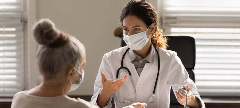 Female doctor speaking with a patient.