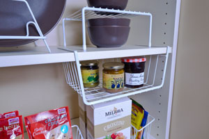 Organized-Living-white-under-shelf-basket-and-cabinet-shelf-on-open-shelving-in-pantry