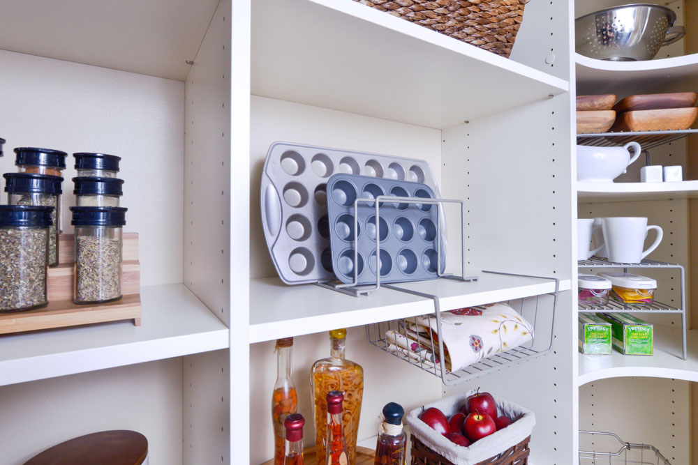 Organized-Living-nickle-4-sort-divider-and-under-shelf-basket-on-pantry-shelf-holding-cookie-sheets-and-towels