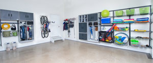 freedomRail-garage-storage-with-shelving-cubbies-cabinets-and baskets-for-sports-equipment-and-pool-toys