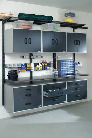 freedomRail-garage-workspace-with-cabinets-and-worktope
