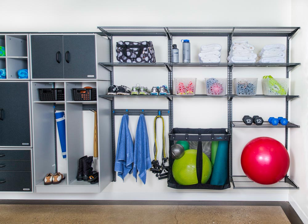 freedomRail-garage-storage-wall-with-ventilated-shelving-hooks-and-ball-basket