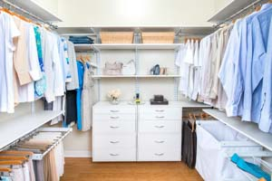 White-freedomRail-his-and-hers-walk-in-closet