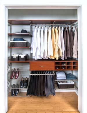 Modern-Cherry-reach-in-closet-with-ventilated-shoe-shelves-pant-rack-and-hanging-rod