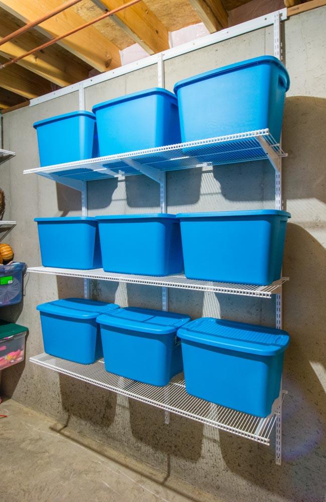 White-freedomRail-storage-room-ventilated shelves-holding-bins