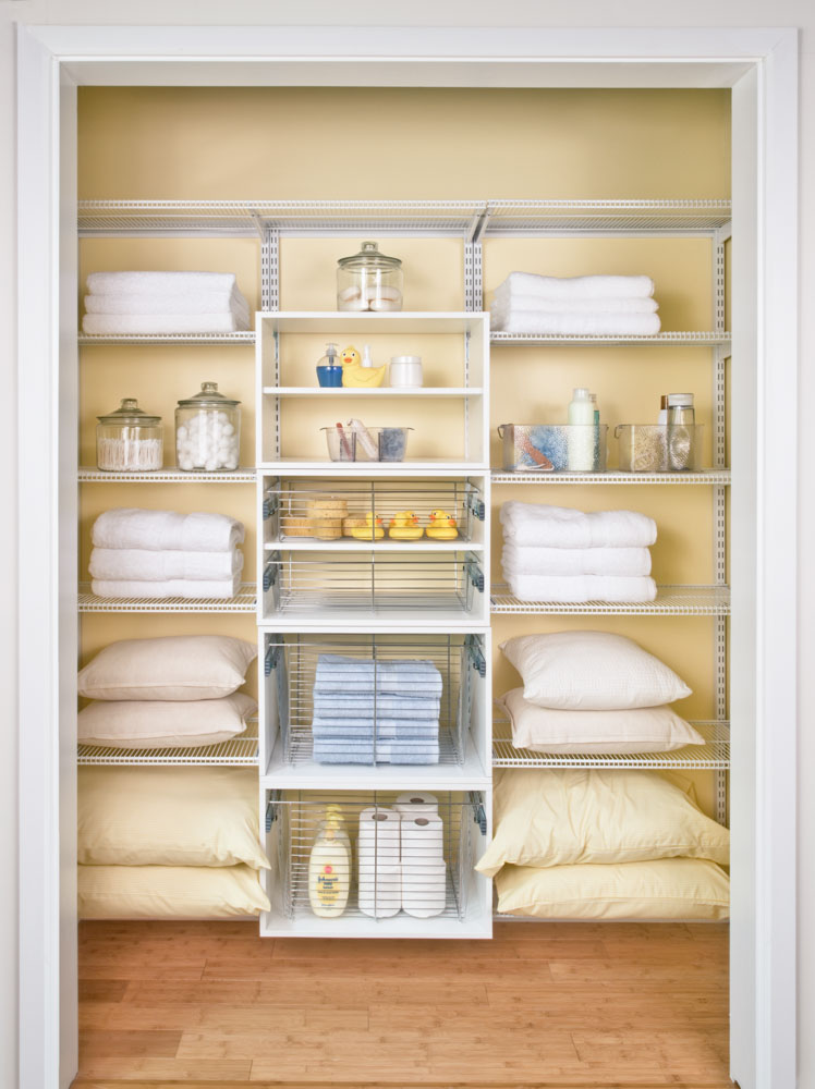 White-freedomRail-linen-closet-with-ventilated-shelving-and-baskets