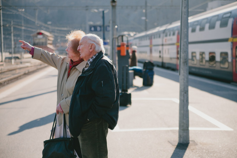 old-couple-at-train-station