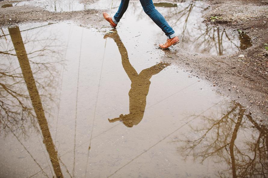 matt walking across puddle of water