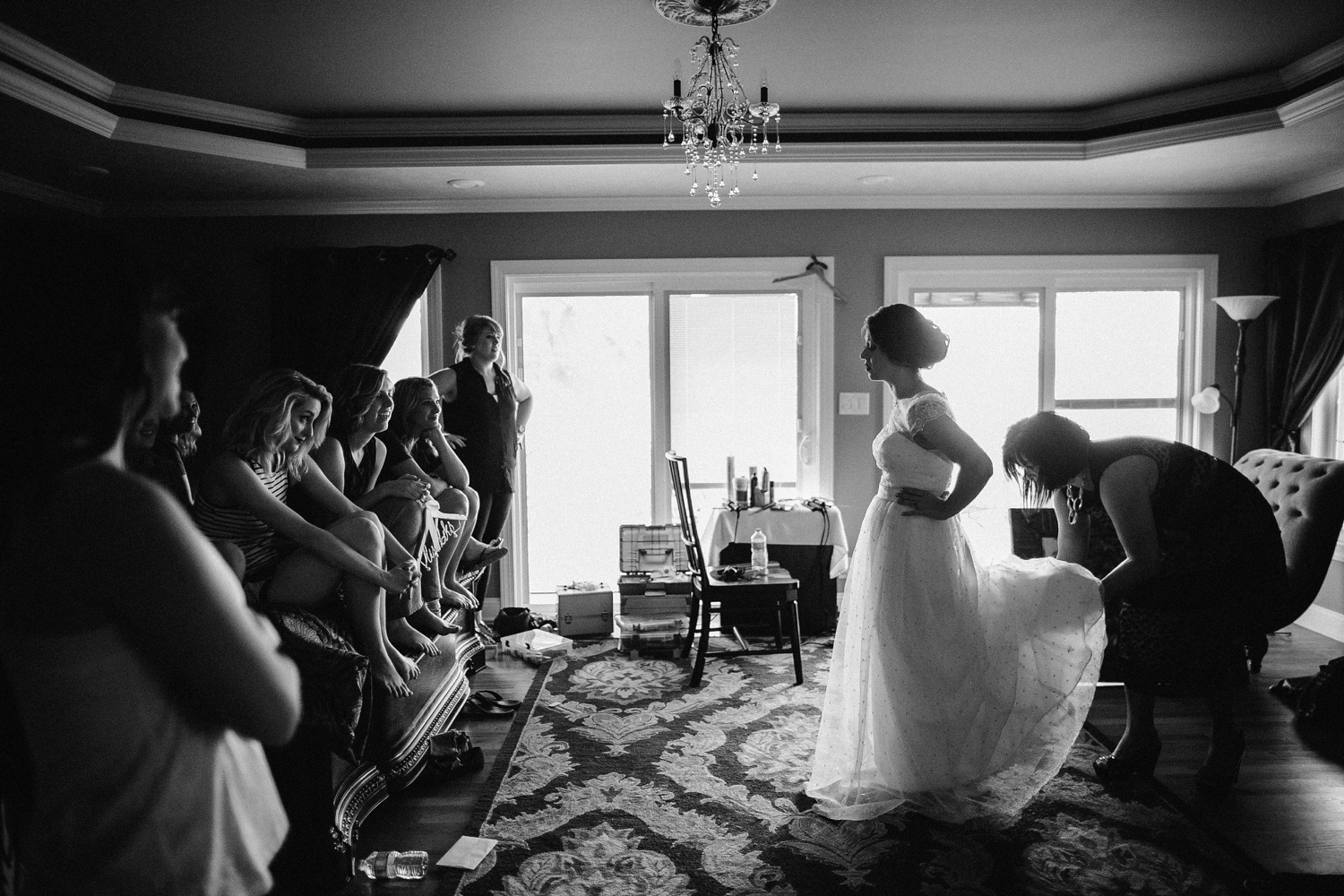 bridesmaids watching bride get ready