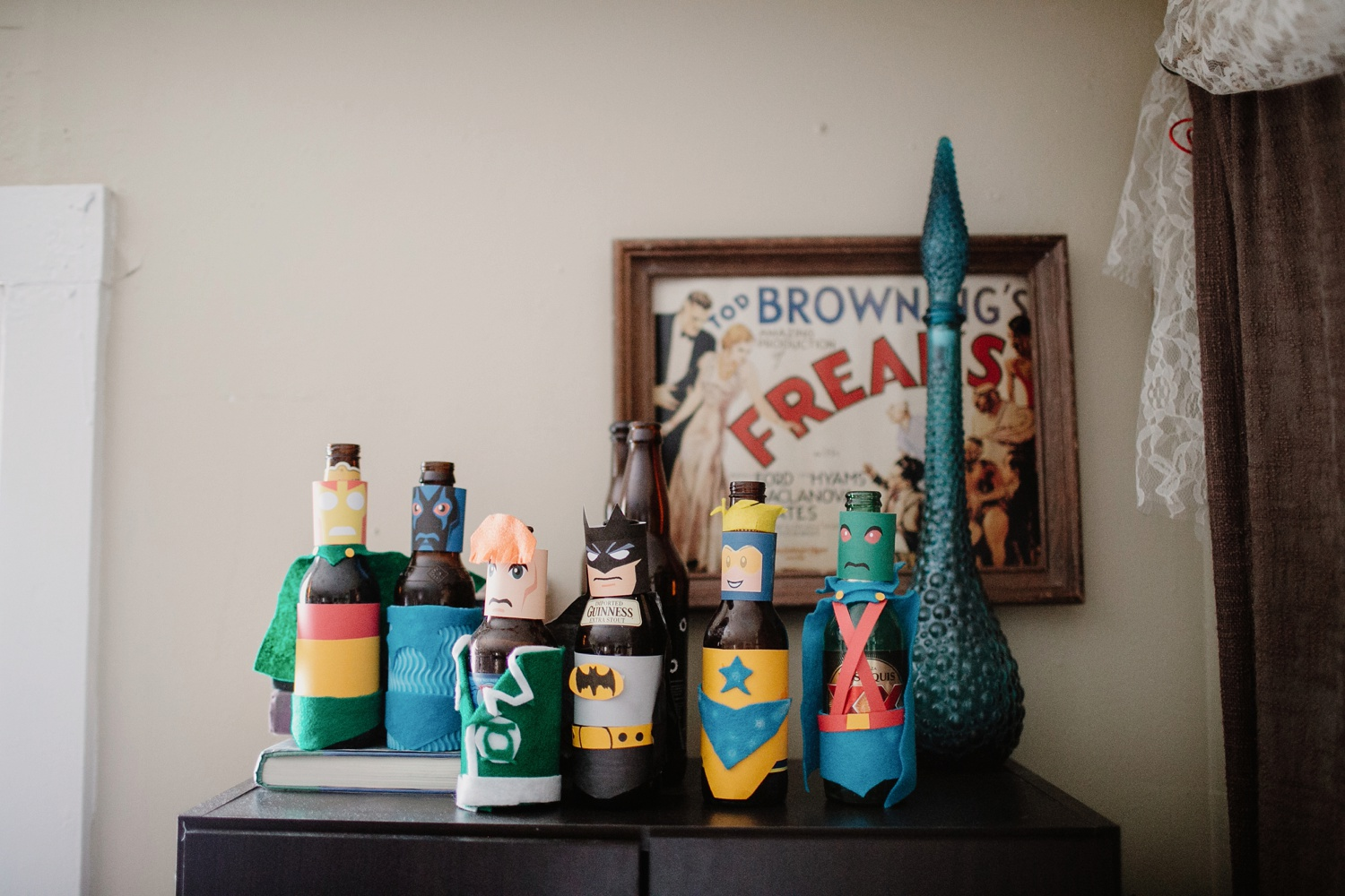 beer bottles decorated as superheros