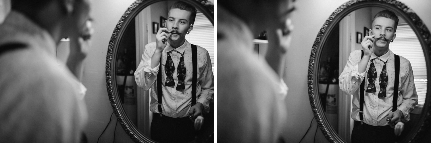 groom prepping mustache in mirror