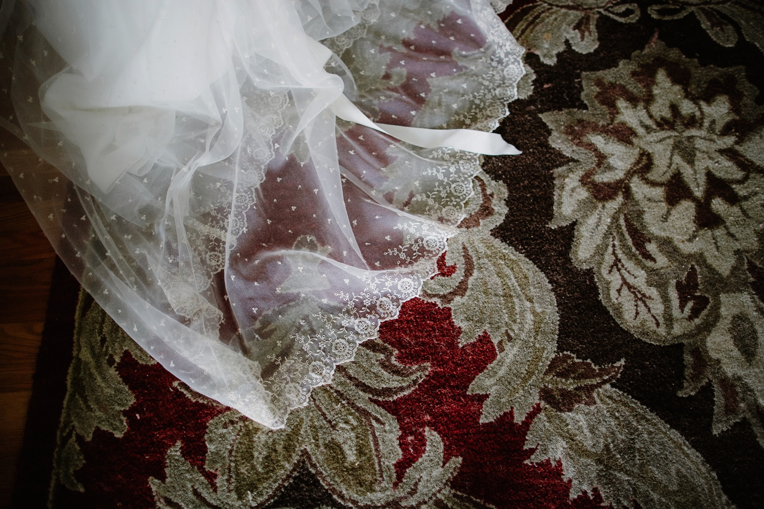 bride lace dress on rug