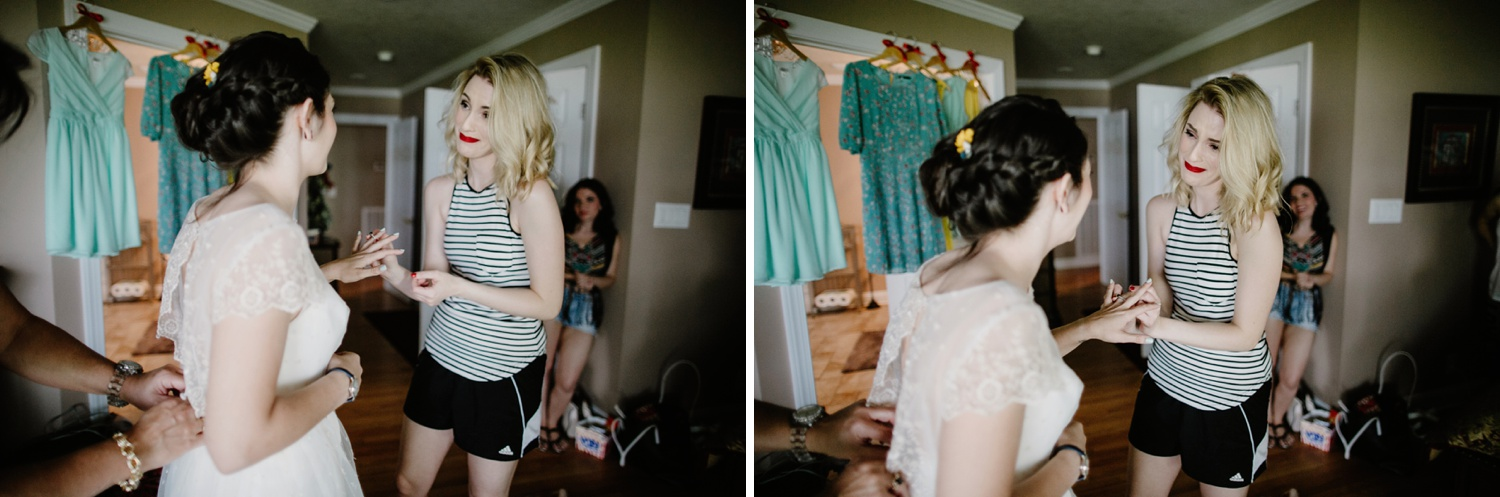 bridesmaid tearing up helping bride get ready