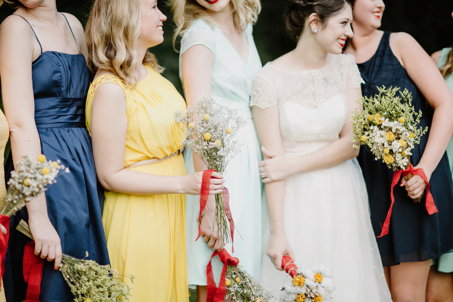 carnival themed wedding with different color bridesmaid dresses