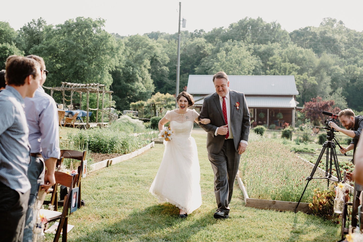 bride walking down aisle with dad at nashville wedding