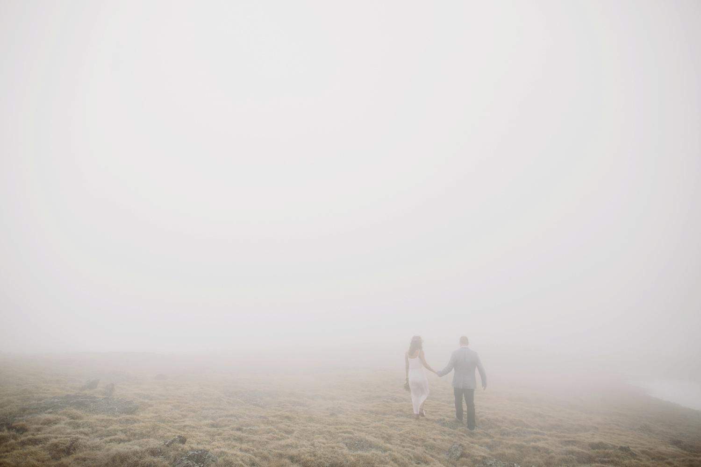 bride-and-groom-walking-in-fog